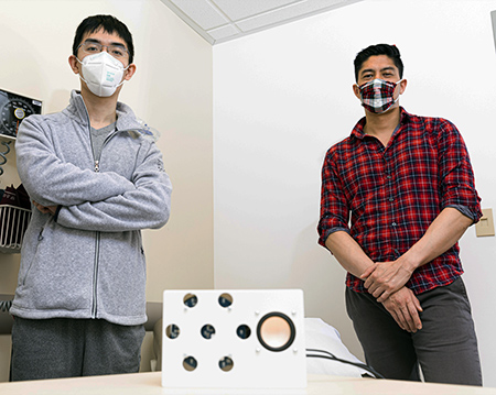 picture of study authors Anran Wang and Dan Nguyen with the smart speaker prototype