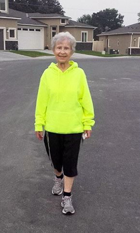 picture of patient Myra Gaines walking in her Kennewick, Washington, neighborhood