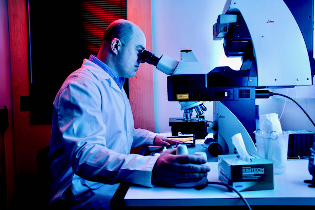 Professor Michael Manookin works at a confocal microscope.