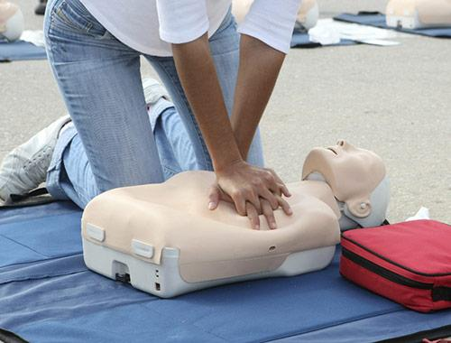 picture of CPR training being performed on mannequin