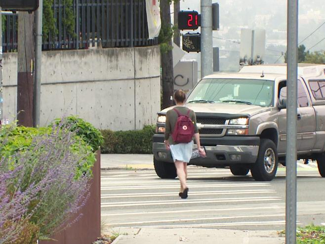 picture of young woman crossing the street