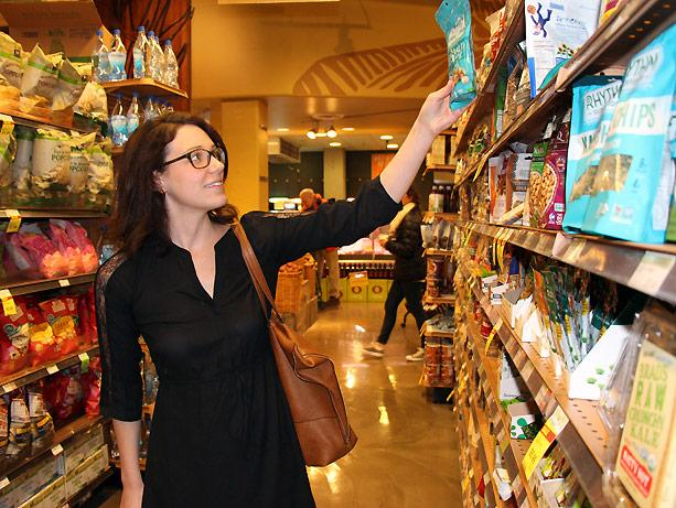 picture of Jamie Bachaus shopping in the snack aisle in Whole Foods.