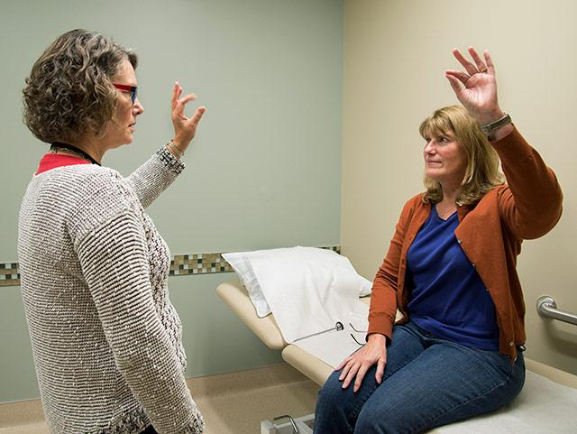 picture of nurse practitioner Hillary Lipe performing a physical exam on a patient at the UW Medicine Multiple Sclerosis Center.