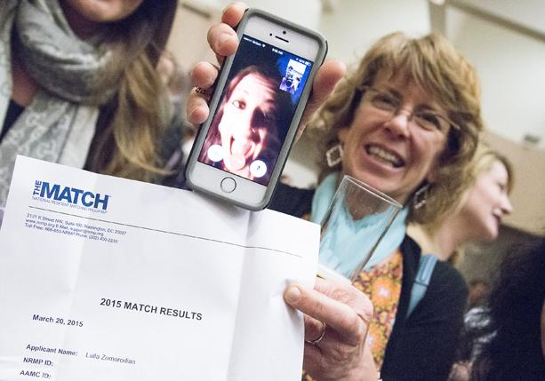 a picture of a woman sharing Match Day news by phone in 2015 at the University of Washington