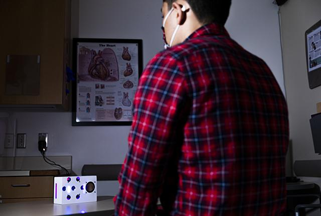 picture of model with smart speaker prototype designed to detect heart rhythms