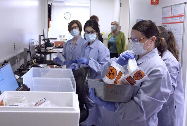 picture of technicians at UW Medicine Virology Lab