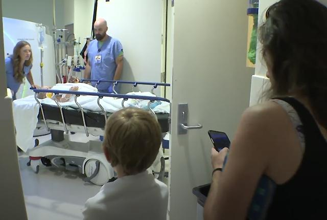 picture of family looking into patient room in hospital