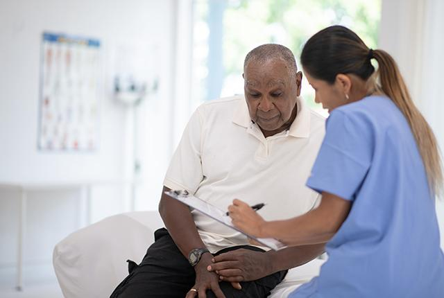 picture of clinician talking with older Black man