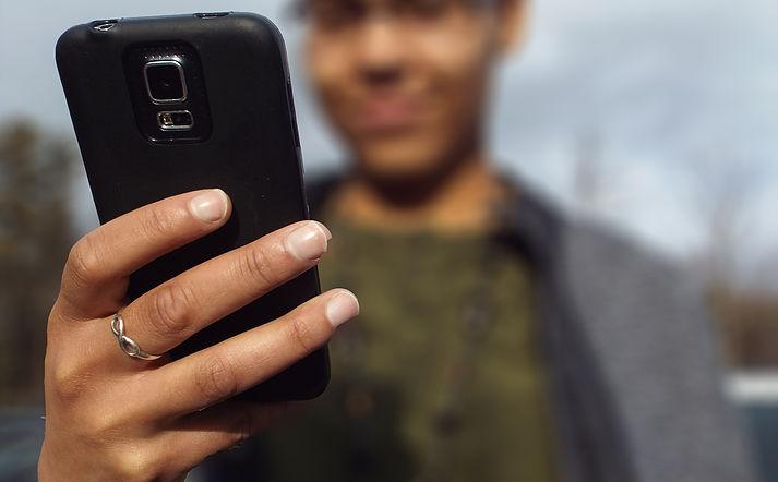picture of a woman using a smartphone