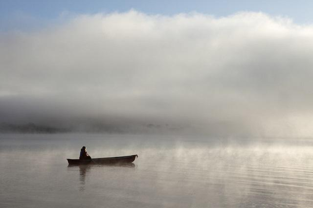 picture of woman paddling canoe
