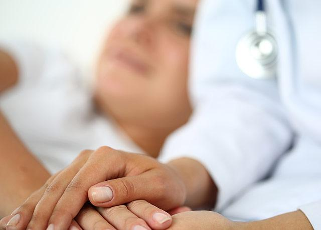 picture of clinician holding the hand of a patient