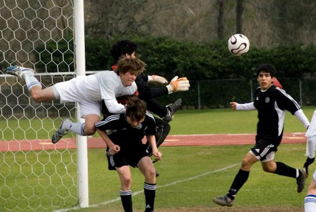 picture of a collision among teen boys playing soccer