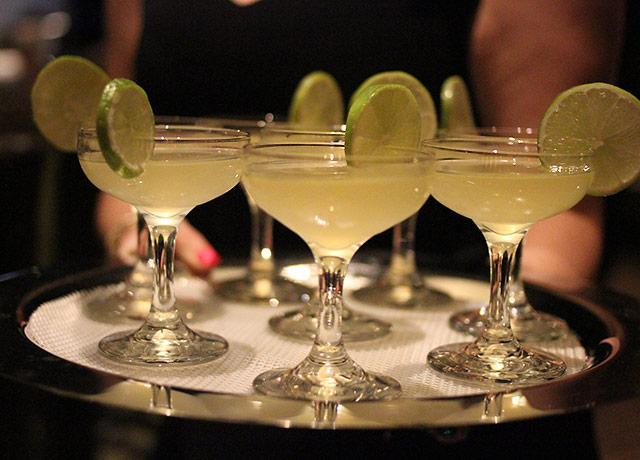 picture of a tray of cocktails being served