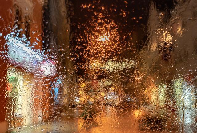 looking at rain through a window at night