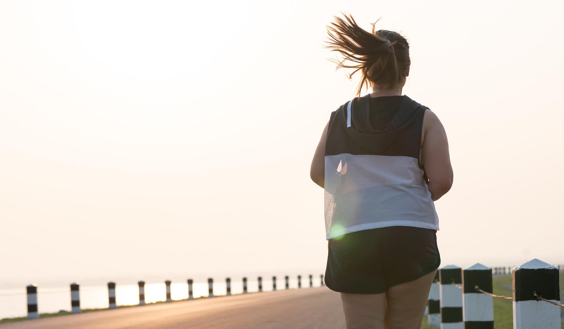 Woman running down boardwalk