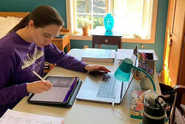 picture of student Grayson Baden studying at home