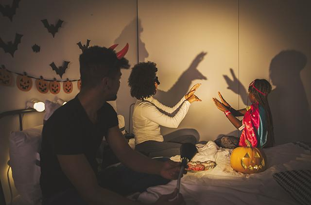 family makes finger shadows at home