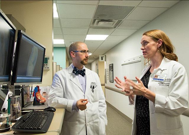 picture of UW Medicine caregivers discussing a patient case