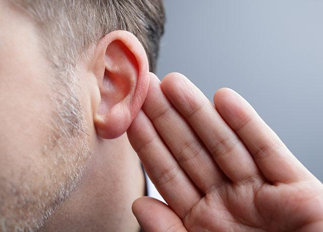 picture of a person indicating trouble hearing