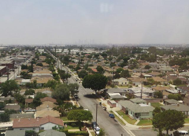 picture of Commerce, California, with Los Angeles hazily in the distance