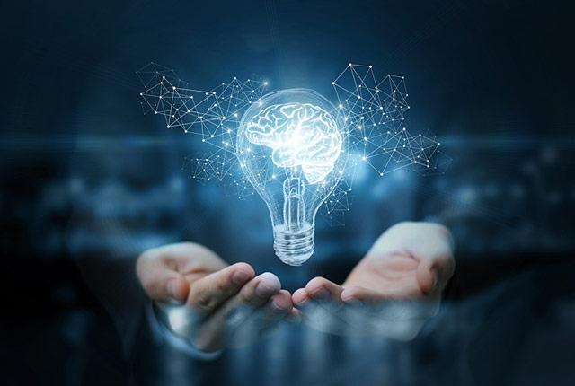 businessman holding a lightbulb