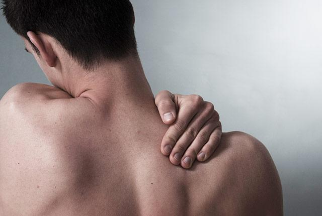 picture of man rubbing his shoulder
