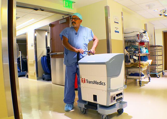 UW Medicine transplant surgeon Jorge Reyes with the liver organ care system