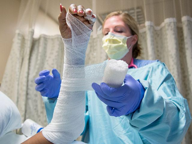 picture of a nurse at Harborview's burn center changing a patient's bandage