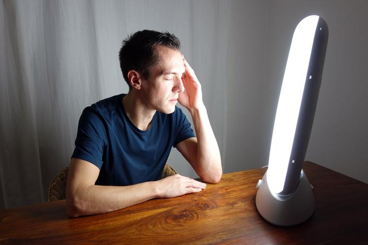 Man in front of SAD light.