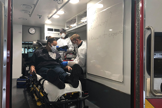 picture of South King County Fire and Rescue paramedics training to care for a patient that may have COVID-19