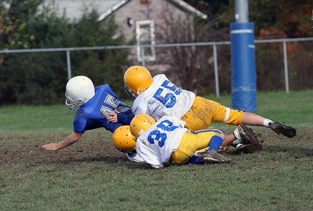 boys playing tackle football