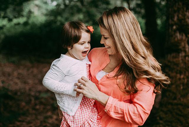 Tatum Fettig holds her daughter, Teagan