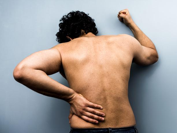 picture of a man expressing back pain