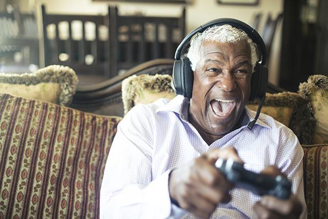 Senior playing video game