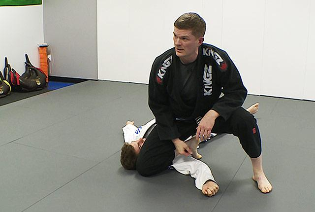 Dr. Nathan White demonstrates a knee-mount move