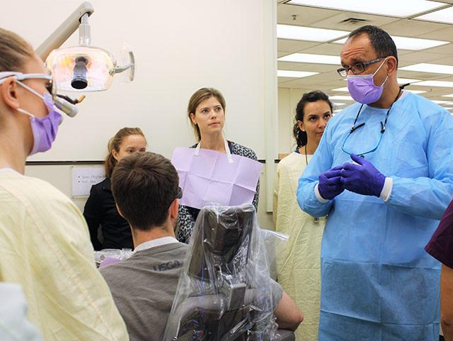 picture of Dr. Sami Dogan leading third-year students through pre-clerkship training at the University of Washington School of Dentistry.
