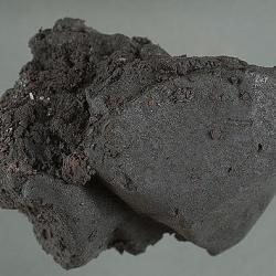 picture of a chunk of black tar heroin