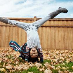Kid doing a handstand.