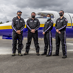 picture of Airlift Northwest flight staff in front of new Learjet