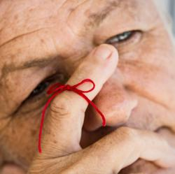 picture of older man with string tied around finger