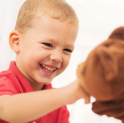 picture of young boy interacting with puppet