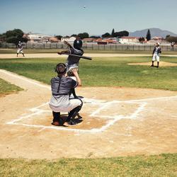 a player hits a baseball