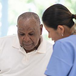 Nurse talking with patient on screening results