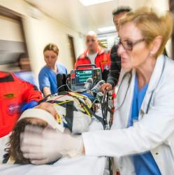 Emergency physicians tend to boy on gurney