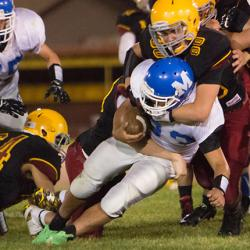 picture of prep football player getting tackled