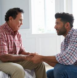 young man talking with his father