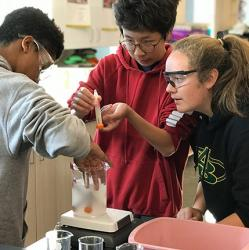 picture of teens experimenting with yeast in a high school class