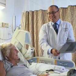 Dr. Danny Dvir shows patient Debbie Davis a video of her heart procedure.