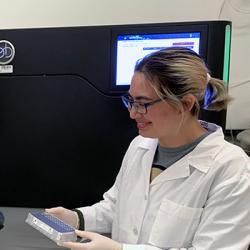 technicians in Eichler lab genome sequencer