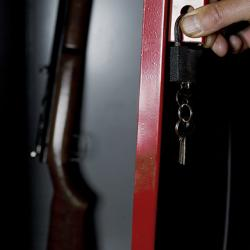 picture of a hand opening a gun safe